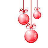 Christmas balls hanging with ribbon bows on white background Stock Photos