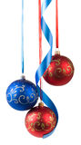 Christmas balls hanging on ribbons Stock Photo
