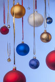 Christmas balls hanging on ribbons. A lot of christmas bolls hanging on ribbons. Different size of balls Stock Images