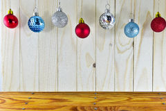 Christmas balls hanging on wooden table royalty free stock image