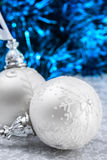 Christmas balls on holiday background. White and silver christmas balls on dark blue bokeh background. Merry christmas card. Xmas. New Year Stock Image