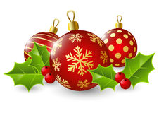 Christmas balls with holly leaves Royalty Free Stock Photos