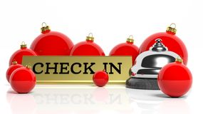 Christmas balls and hotel bell with check in tag Royalty Free Stock Photos