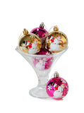 Christmas balls in the ice cream glass bowl isolated Royalty Free Stock Images