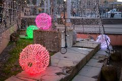 Christmas balls illuminated, Genoa, Italy stock images