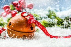 Christmas balls jingle bells. Red  ribbon with text Happy Christmas. Snowy abstract background and decoration Royalty Free Stock Photos