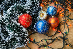 Christmas balls and light garland Stock Photo