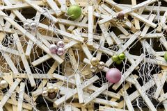 Christmas balls on light roots and wooden planks. Installation.  royalty free stock image