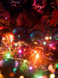 Christmas balls with lights. Multicolored closeup Сhristmas balls, electric & custom garland composition Royalty Free Stock Photos