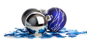 Christmas balls lying on blue stars Stock Images