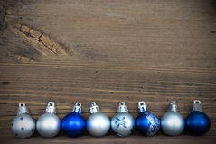 Christmas Balls Lying on Wood with Copy Space Royalty Free Stock Photos