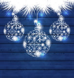 Christmas balls made in snowflakes on blue wooden background. Illustration Christmas balls made in snowflakes on blue wooden background - vector Stock Illustration