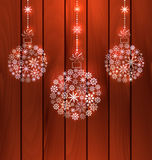 Christmas Balls Made of Snowflakes. Illustration Christmas Balls Made of Snowflakes, Wooden Background - Vector Royalty Free Stock Image