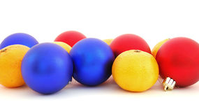 Christmas balls and mandarins. On a white background Stock Photography