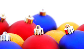 Christmas balls and mandarins. On a white background Royalty Free Stock Photography
