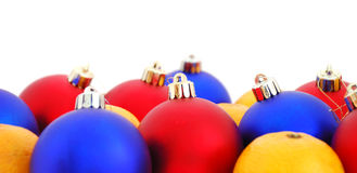 Christmas balls and mandarins. On a white background Royalty Free Stock Images