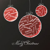 Christmas balls with multilingual greetings pattern Royalty Free Stock Image