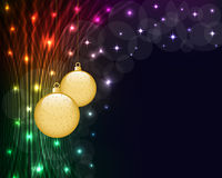 Christmas balls and neon lights. Christmas balls on dark abstract background of glowing neon lights. Copy space for text Stock Photos