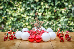 Christmas balls next to a star and a group of Christmas characte Royalty Free Stock Image