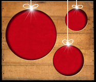 Christmas Balls - Old Wooden Boards. Brown wooden wall with a hole in the shape of Christmas balls with red velvet background Stock Image