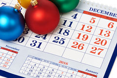 Christmas Balls On Calendar Stock Photography