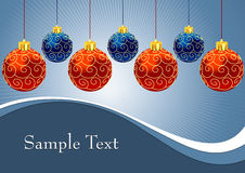 Christmas balls with ornament on blue background Stock Photo