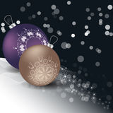 Christmas balls with ornament and snow. On a dark background. Brown, purple Stock Image