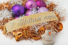 Christmas balls. And ornaments with the words Happy New Year Royalty Free Stock Photos