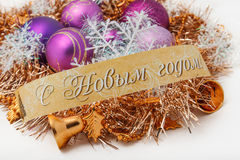 Christmas balls. And ornaments with the words Happy New Year Royalty Free Stock Image
