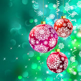 Christmas balls over green bokeh. EPS 8 Stock Image