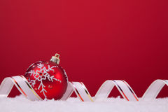 Christmas balls over a red background Royalty Free Stock Photos