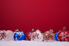 Christmas balls over a red background stock photography