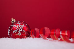 Christmas balls over a red background Royalty Free Stock Images