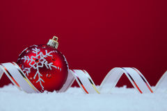 Christmas balls over a red background Stock Photos
