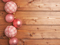 Christmas balls over the wooden background Stock Photography