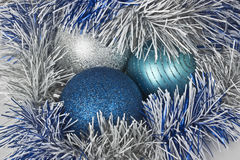 Christmas balls and paper streamer Stock Photos