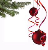 Christmas balls and paper streamer Stock Images