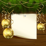 Christmas balls and paper. Wooden background with branches of Christmas tree, baubles and paper, illustration Stock Photo