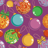 Christmas balls pattern. Seamless vector pattern with christmas balls on violet Stock Photos