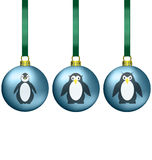 Christmas balls with penguins family Royalty Free Stock Photo