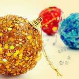 Christmas balls. Picture of some christmas balls of different colors with a retro effect stock photo
