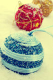 Christmas balls. Picture some christmas balls of different colors on the snow, with a retro effect Stock Photography