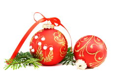 Christmas balls and a pine branch. Stock Photo