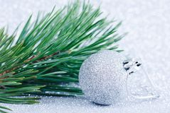 Christmas decoration with pine branch and shiny balls. stock photo