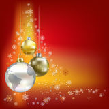 Christmas balls and planet red background Stock Photos