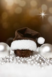 Christmas balls, pointed hat and pearls, festive brown backgroun Stock Images
