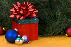 Christmas balls and present Stock Images