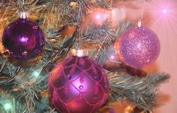 Christmas balls. In purple color with added lighting effects royalty free stock photography