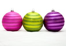 Christmas balls in purple - pink and green Royalty Free Stock Image