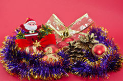Christmas balls and purple tinsel Royalty Free Stock Photos